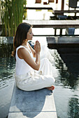 Woman meditating at the edge of a pool, Spa, Wellness, Relaxation, Health
