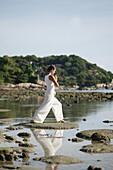 Woman doing Yoga exercises on the beach, Wellness, Relaxation, Health, Thailand