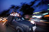 Car procession on Avienda Miguel Aleman, La Costera, Acapulco de Ju‡rez, Guerrero, Mexico