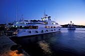 Yacht anchoring in harbor, Porto Cervo, Costa Smeralda, Gallura, Sardinia, Italy