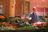 Smiling man at a market stand, oasis city Timimoun, Algeria, Africa