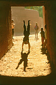 Boy doing handstand, Algeria, Africa