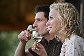 Young couple drinking white wine, Heiligenblut, Hohe Tauern National Park, Carinthia, Austria