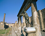 Apollo statue and temple. Ruins of the old Roman city of Pompeii. Italy