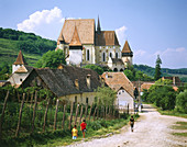 Saxon fortified church of Biertan and village, near Sighisoara. Transylvania. Romania