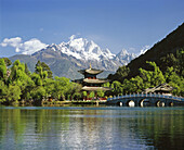 Deyue Pavilion (Moon-Embracing Pavilion) at the Hei Long Tan (black Dragon Pool) Park. Jade Dragon Snow Mountain (Yulong Mountain), Lijiang. Yunnan province, China