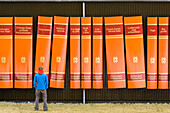 Man in front of giant book poster, Iceland