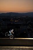 Man trial biking on edge of a highrise building, Linz, Upper Austria, Austria