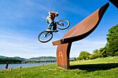 Man trial biking on sculpture in park, Linz, Upper Austria, Austria