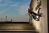 Man trial biking along wall of the town hall, Linz, Upper Austria, Austria