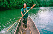 Shaman Vargas sailing in a canoe by the Puyo river. Indi Churis community. Pastaza province. Ecuador