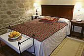 Rural tourism. A bedroom in Villa de Abalos hotel
