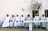 Group of friends having tea. Musandam peninsula. Oman