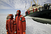 Asiatic tourists with special diving costumes for the iced Baltic Sea. Sampo Icebreaker. Kemi. Gulf of Bothnia. Baltic Sea. Finland.