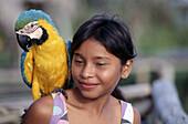 Guayo girl with macaw. Orinoco. Venezuela.