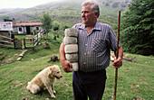 Shepherd with Gorbea cheeses. Gorbea mount. Álava. Vizcaya. Euskadi. Spain.