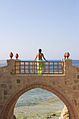 Woman Standing on Bridge in Holiday Resort in Swimming Costume, Red Sea, Egypt.