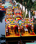 Boats in the channel of Xochimilco. Mexico City