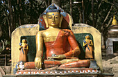 Seated Buddha statue on Eastern stairway at base of hill to Swayambhunath Temple. Katmandu. Nepal