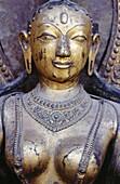 Detail of 16th.century metal sculpture of River Goddess Jamuna at doorway of Taleju Bhavani Shrine in Mul Chowk, Darbar Square. Patan. Katmandu Valley. Nepal.