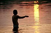 Offering to sun god in Narmada River, Jabalpur. Madhya Pradesh, India