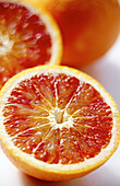 Aliment, Aliments, Citrus fruits, Close up, Close-up, Closeup, Color, Colour, Detail, Details, Food, Foodstuff, Fruit, Fruits, Grapefruit, Grapefruits, Half, Halves, Health, Healthy, Indoor, Indoors, Interior, Nourishment, Still life, Vertical, Vitamin,