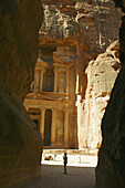 Al-Khazneh, cut out from the red sandstone meets the visitors in Petra (UNESCO world heritage site). Jordan