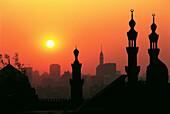 Sunset on Hassan Mosque minarets. Cairo. Egypt