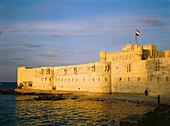 Qait Bay Turkish fortress at dusk. Alexandria. Egypt