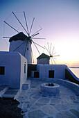 Windmills at dusk. Mykonos. Greece