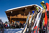Skiers sitting in front of a ski lodge, Bavarian Alps, Germany