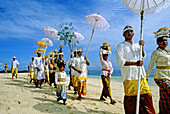 Purification ceremony hold on a Nusa Dua beach nearby touristic hotels. Bali island. Indonesia