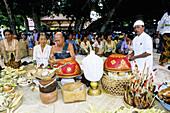 Brahman leading a purification ceremony hold on a Nusa Dua beach nearby touristic hotels. Bali island. Indonesia