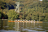 Rowing boat, coxed eight with Coxswain, Shaft Tower in the background, Baldeney Lake, Essen, Ruhr Valley, Ruhr, Northrhine, Westphalia, Germany