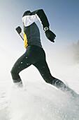 Man jogging through snow, Styria, Austria