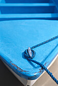 Blue, Boat, Boats, Close up, Close-up, Color, Colour, Concept, Concepts, Daytime, Detail, Details, Exterior, Knot, Knots, Outdoor, Outdoors, Outside, Possession, Rope, Ropes, Security, Tied, Vertical, A75-193002, agefotostock