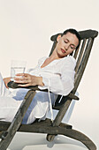 rs, 30-40 years, Adult, Adults, Back, Backs, Beauty, Beverage, Beverages, Calm, Calmness, Caucasian, Chair, Chairs, Closed eyes, Color, Colour, Contemporary, Drink, Drinks, Facial expression, Facial e