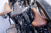 Bicycle, Bicycles, Bike, Bikes, Biking, Color, Colour, Concept, Concepts, Cycle, Cycles, Daytime, Detail, Details, Exterior, Horizontal, Lean, Leaning, Object, Objects, Old, Old-fashioned, Outdoor, Outdoors, Outside, Rust, Rusty, Saddle, Saddles, Thing,