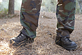 Anonymous, Boot, Boots, Camouflage clothes, Color, Colour, Contemporary, Country, Countryside, Daytime, Detail, Details, Exterior, Feet, Foot, Horizontal, Human, Leg, Legs, Military, Nature, One, One person, Outdoor, Outdoors, Outside, People, Person, Pe