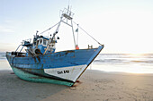 Beach, Beaches, Boat, Boats, Coast, Coastal, Color, Colour, Daytime, Deserted, Exterior, Fishing boat, Fishing boats, Horizon, Horizons, Horizontal, One, Outdoor, Outdoors, Outside, Sea, Shore, Shores, Stranded, Sunrise, Sunrises, Vessel, Vessels, A75-29