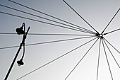 Cable, Cables, Color, Colour, Concept, Concepts, Daytime, Exterior, Low angle view, Outdoor, Outdoors, Outside, Pole, Poles, Skies, Sky, Street lamp, Street lamps, View from below, Wire, Wires, Worm s eye view, A75-459464, agefotostock