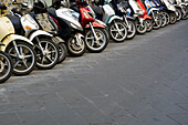Bike, Bikes, Car park, Car parks, Cities, City, Color, Colored, Colorful, Colors, Colour, Coloured, Colourful, Colours, Cycle, Cycles, Daytime, Exterior, Lined up, Lined-up, Lining up, Lining-up, Many, Motorbike, Motorbikes, Motorcycle, Motorcycles, Nobo