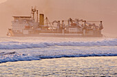 Activity, Beach, Beaches, Cargo container, Cargo containers, Cargo ship, Cargo ships, Color, Colour, Daytime, Economy, Exterior, Foam, Foamy, Fog, Freight transportation, Freighter, Freighters, Froth, Horizon, Horizons, Load, Mist, Outdoor, Outdoors, Out