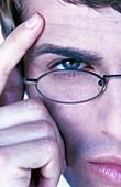 Adult, Adults, Caucasian, Caucasians, Color, Colour, Concentrate, Concentrating, Concentration, Contemporary, Eyeglasses, Face, Faces, Finger, Fingers, Gesture, Gestures, Gesturing, Glasses, Half, Halves, Hand, Hands, Headshot, Headshots, Human, Intellig