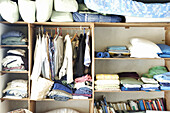 Arrangement, Closet, Closets, Clothes, Color, Colour, Concept, Concepts, Garment, Garments, Home, Horizontal, Housework, Indoor, Indoors, Interior, Order, Shelf, Shelves, Shelving, Sorting, Wardrobe, Wardrobes, CatV9, A75-614165, agefotostock