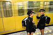 Schoolboys in black uniform in subway. Tokyo, Japan