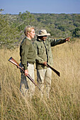 Park Rangers Ryan Kewley and Thomas Nsele. Game drive in the Phinda private park. Kwazulu-Natal province. South Africa