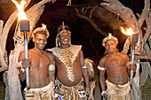 The Chief welcoming visitors at night. The Simunye zulu village where visitors can be accomodated in zulu style, traditional chief Biyela. Kwazulu-Natal province. South Africa