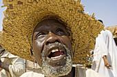 Corn seller at market, Atbarah. Upper Nubia, Blue Nile state, Sudan