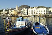 Boatman mooring a boat. Port. Lipari. Aeolian Islands. Sicily. Italy